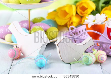Easter decoration, eggs and tulips on table on natural background