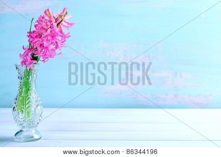 Beautiful hyacinth flower in vase on wooden table