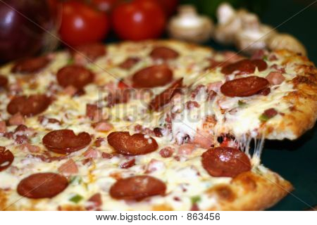 Pizza With Lifted Slice
