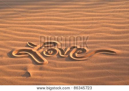 Love message drawn in sand