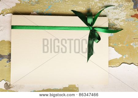 Greeting card for Saint Patrick's Day on cracked wooden background