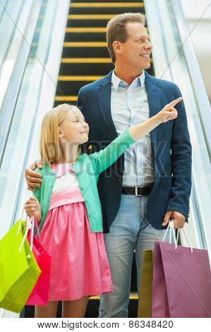 Father And Daughter Shopping.