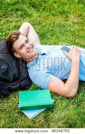 Man Relaxing On Grass.