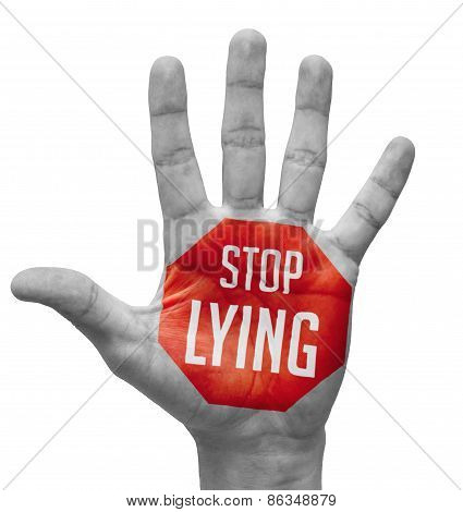 Stop Lying Concept on Open Hand.