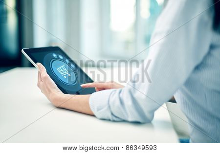 business, technology, online shopping and people concept - close up of woman with tablet pc computer at office or home