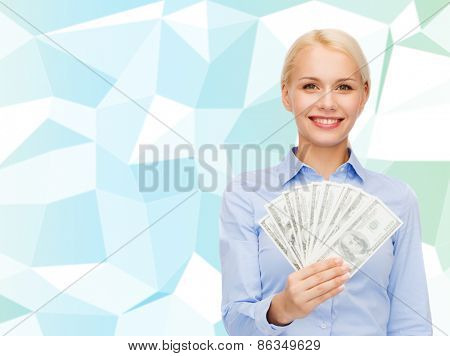 business, success, fortune and finances concept - young businesswoman with dollar cash money over blue graphic low poly background