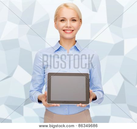 business, technology, internet and advertisement concept - smiling businesswoman with blank black tablet pc computer screen over gray graphic low poly background