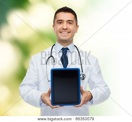 medicine, profession, advertisement and healthcare concept - smiling male doctor showing tablet pc computer blank screen over green background