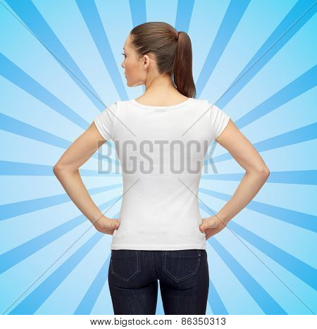 t-shirt design, advertisement and people concept - woman in blank white t-shirt over blue burst rays background from back