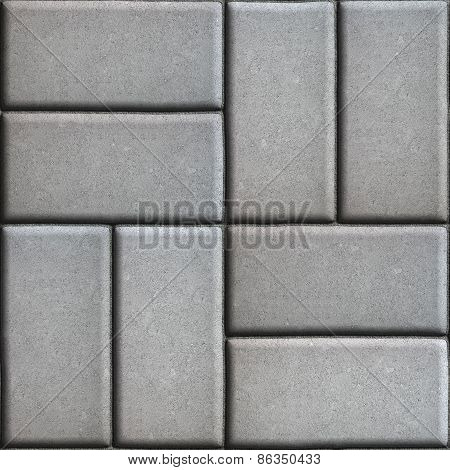 Gray Paving Slabs of Rectangles Laid Out on Two Pieces Perpendicular to Each Other.