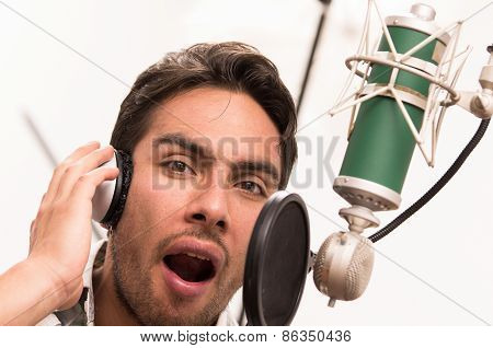 handsome man singing in music studio