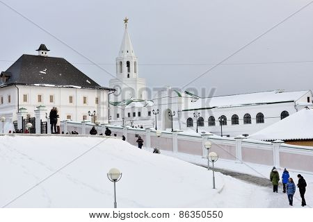 KAZAN, RUSSIA - JANUARY 4, 2015: Tourists in Kazan Kremlin in a winter day. White tower on the back is Spasskaya tower built in 1556-1562