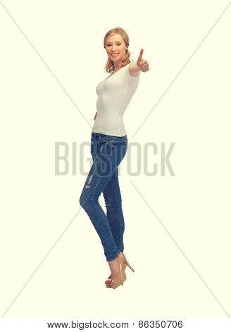 happy woman in blank white t-shirt with thumbs up