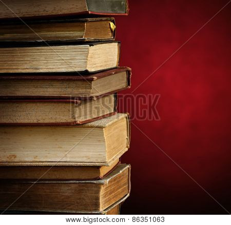 antique books on elegant red background. with space for your text.