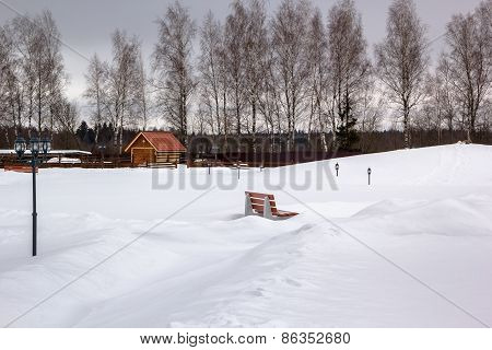 Snow Park With Benches And Lanterns