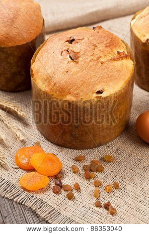 Traditional Italian Panettone Cake Sweet Desset Bread With Raisins And Dried Apricots On Vintage Tex