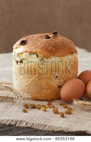 Traditional Easter Holiday Cake Sweet Bread Also Called Kulich With Raisins And Eggs On Vintage Text