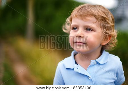 Preschool Boy Walking On A Country Road
