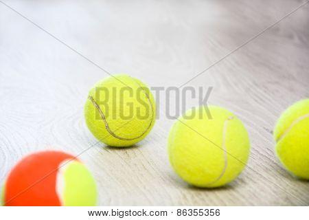 tennis balls on wood