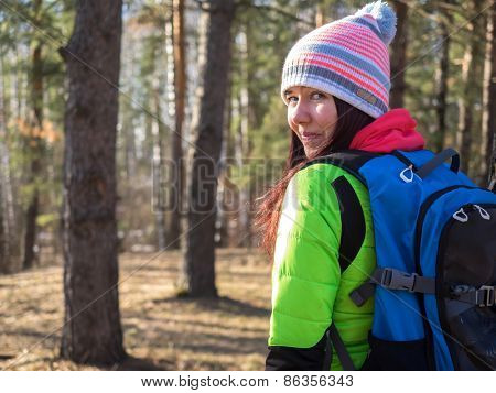 Close up portrait of woman hiking in the forest
