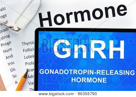 Papers with hormones list and tablet  with words Gonadotropin-releasing hormone (GnRH) .