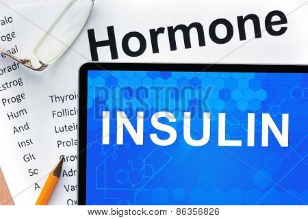 Papers with hormones list and tablet  with word  insulin.