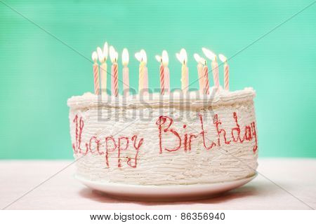 Birthday cake with candles on color background