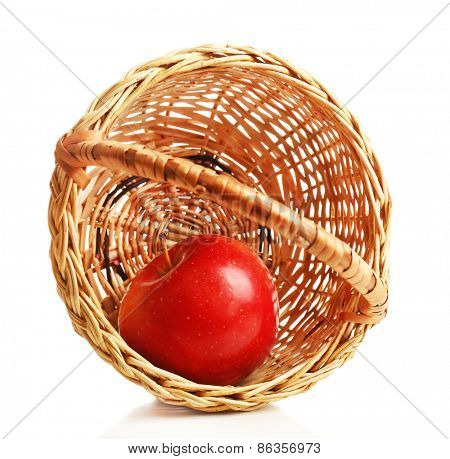 Apple and wicker basket isolated on white