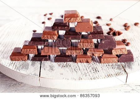 Pyramid of squared chocolate on wooden table