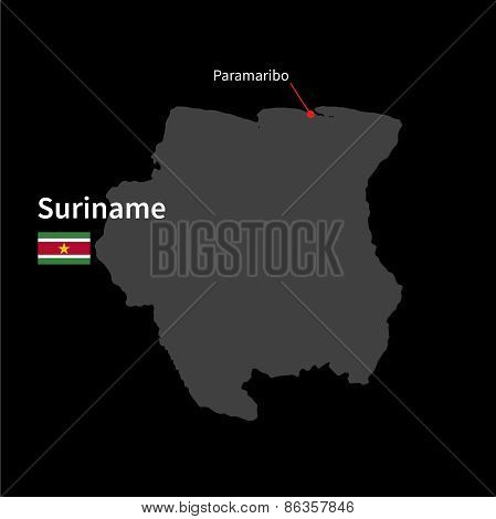 Detailed map of Suriname and capital city Paramaribo with flag on black background