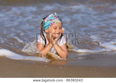 Child resting on the beach