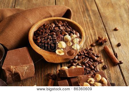 Still life with set of chocolate on wooden table, closeup