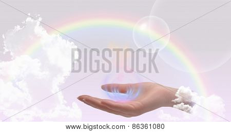 Healing hand on a sky background with rainbow