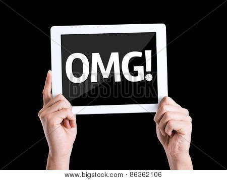 Tablet pc with text OMG (Oh My God) isolated on black background