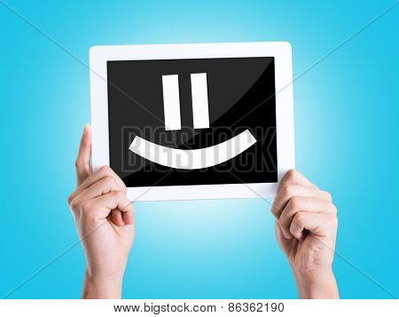 Tablet pc with text Smiley Face with blue background