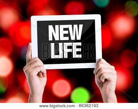 Tablet pc with text New Life with bokeh background