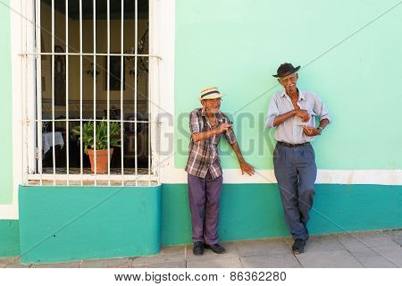 Trinidad - February 24: Unknown People Smoking Cigar On Street Of Trinidad On February 24, 2015 In T