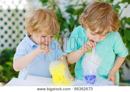 Two Happy Boys Making Experiment With Colorful Bubbles