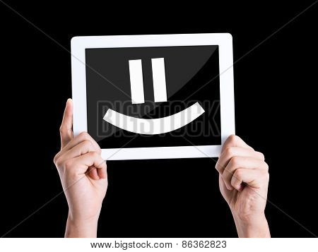 Tablet pc with text Smiley Face isolated on black background