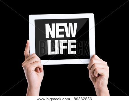 Tablet pc with text New Life isolated on black background