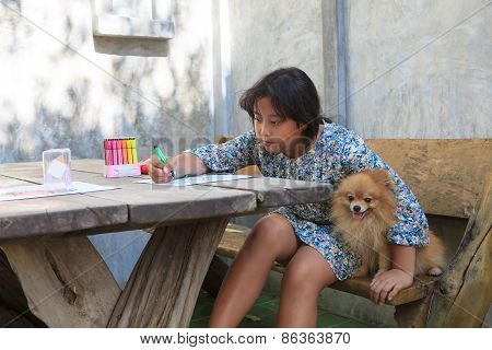 Girl And Pomeranian Dog At Home