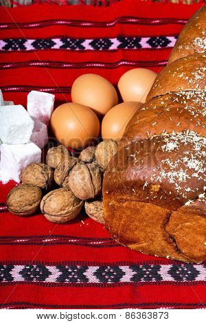 Romanian sponge cake and ingredients, eggs, walnuts, jelly,on