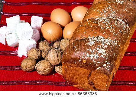 Romanian sponge cake and ingredients, eggs, walnuts, jelly