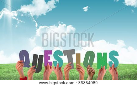 Hands holding up questions against field and sky