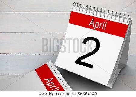 April calendar against painted blue wooden planks