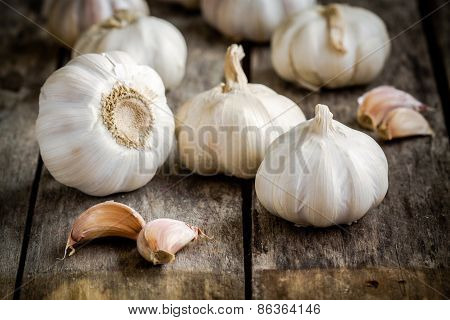 Organic Garlics With Cloves On A Wooden Background