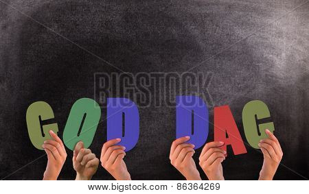 Hands holding up god dag against black background