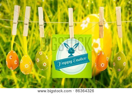 Happy Easter greeting against orange easter egg in the grass