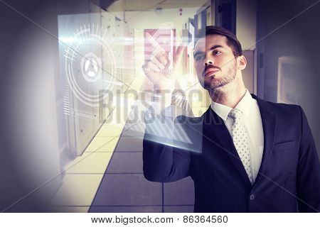 Concentrated businessman measuring something with his fingers against data center