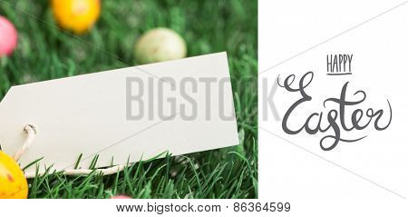 happy easter graphic and little eggs with blank on grass